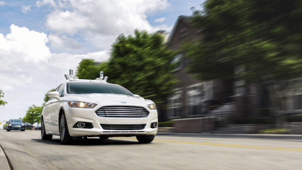 Ford fully autonomous Fusion Hybrid research vehicle on streets of Dearborn, MI. Ford has been researching autonomous vehicles for more than a decade and currently tests fully autonomous vehicles in Michigan, Arizona and California, and will triple its autonomous vehicle test fleet this year to have the largest of any automaker.